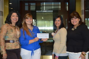 Adult & Teen Challenge of Texas receives donation from Valero. From left to right is Sylvia Rodriguez, VP of the Valero Foundation; Sarah Davey, San Antonio Women's Director for Adult and Teen Challenge of Texas; Rita Vela, Teen Challenge student in the re-entry program; and Rosa Ramirez, Valero staff.